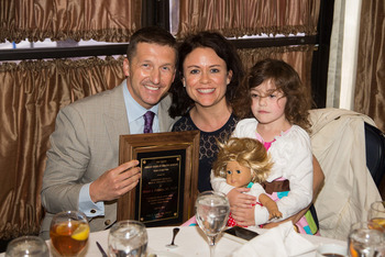 Dr. Michael Policastro displays his award with his family