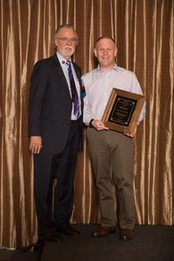 Dr. John Lyman presents Dr. Gary Katz [right] with the Emergency Physician Leadership Award